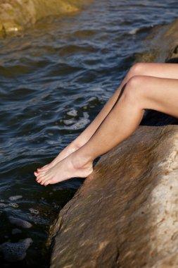 Womans legs testing water