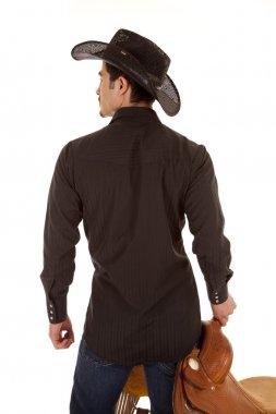 Cowboy back with saddle
