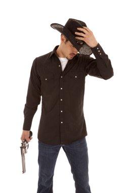 Cowboy holding hat and gun