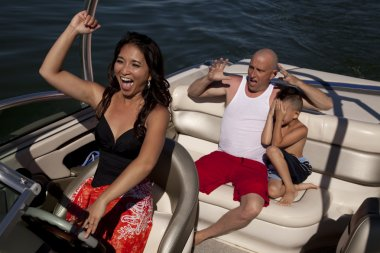 Happy woman driving boat scared boys