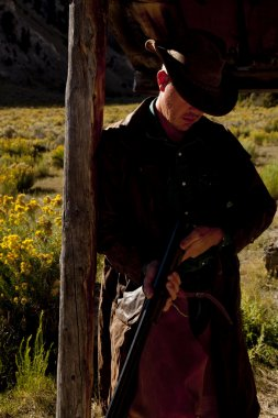 Cowboy by post with gun