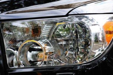Black modern automobile headlight as background
