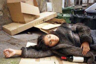 Drunk woman in trash
