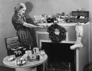 Woman with Christmas presents on mantle