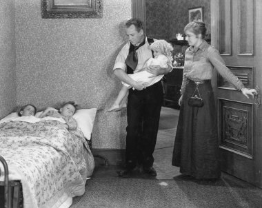 Parents with children at bedtime