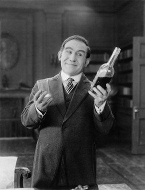 Portrait of happy man having a drink
