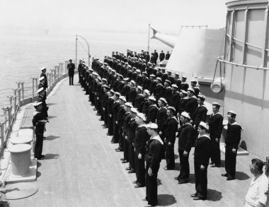 Sailors at attention on naval ship