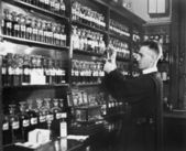 Man in a pharmacy mixing medicine