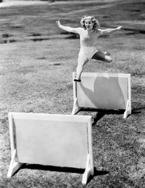 Woman jumping hurdles labeled with years