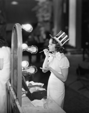 Woman in costume applying makeup