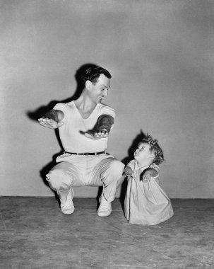 Baby girl imitating dad