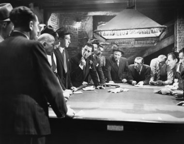 Mobsters meeting around pool table