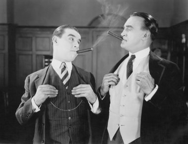 Two men smoking cigars