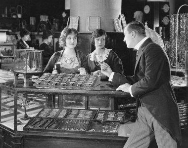 Man scolding saleswomen