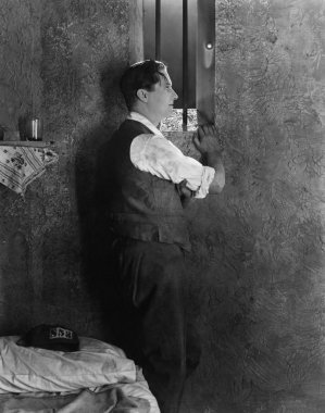 Man at window of prison cell