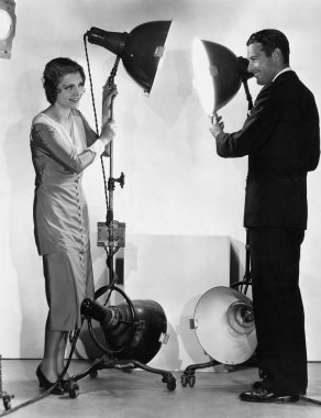 Man and woman with lights on stands