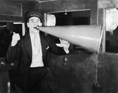 Man with huge megaphone