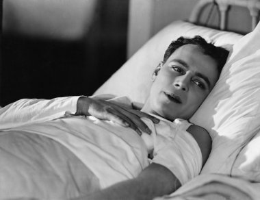 Portrait of injured man in bed