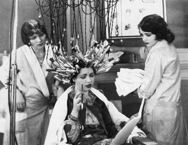 Woman having hair done in salon