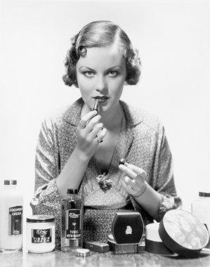 Woman applying cosmetics