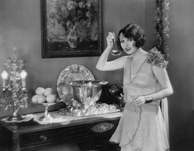 Portrait of woman with ladle and punch bowl