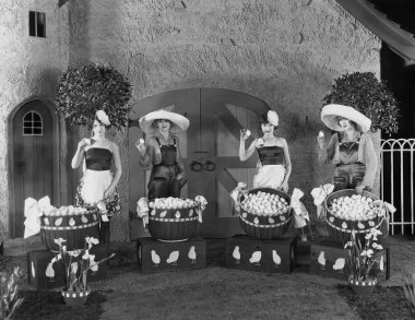 Women posing with huge baskets of eggs
