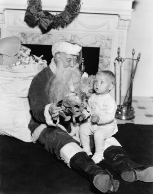 Excited child with Santa Claus