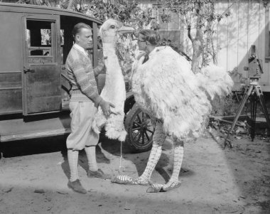 Men with ostrich costume