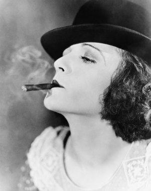 Closeup of woman smoking cigar