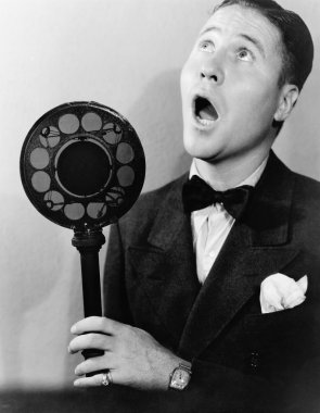 Man singing with radio microphone