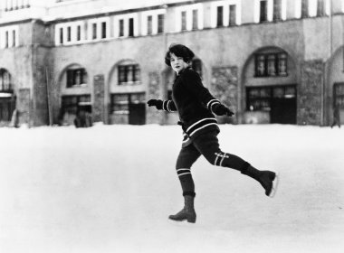 Woman ice skating outside