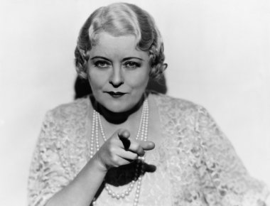 Portrait of mature woman pointing finger
