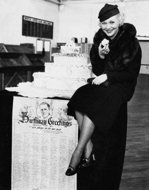 Portrait of woman eating birthday cake