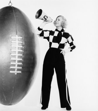 Woman with megaphone and huge football
