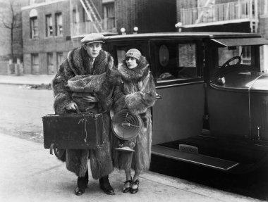 Couple wearing fur coats