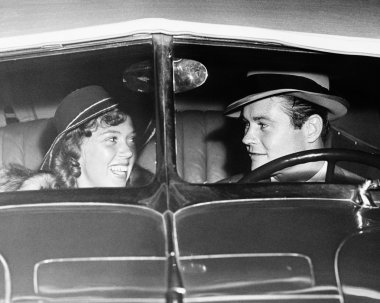 Happy couple in antique car