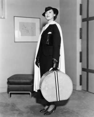 Portrait of woman carrying hatbox