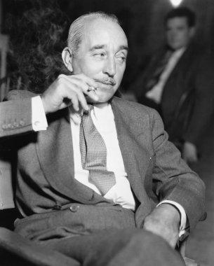 Elegant man sitting and smoking a cigarette
