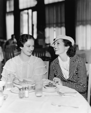 Two women sitting together in a restaurant