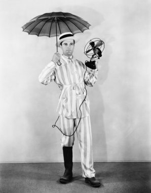 The weather man with umbrella, boot and fan