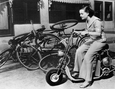 Leaving bicycles in the dust, a young woman fancies a miniature motorbike