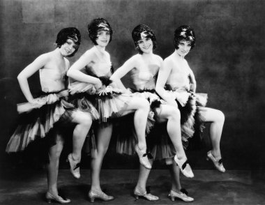Portrait of four young women performing a dance