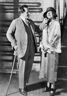 Man and a young woman in a hat looking at each other