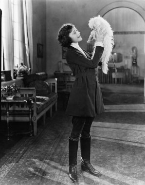 Young woman playing with her dog