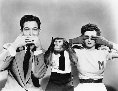 Man, woman and a monkey depicting See No Evil, Speak No Evil, Hear No Evil