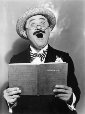 Man holding a book and singing