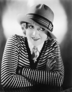 Portrait of a young woman in a hat smiling