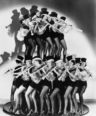 Women in costumes performing a clarinet concert