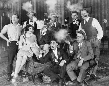 Group of sitting in a living room smoking