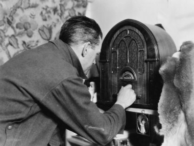 Man tuning the radio